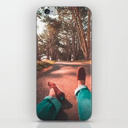Chilling in The Tree Tunnel iPhone Skin