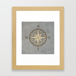compass on cement background Framed Art Print