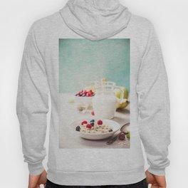 Oatmeal porridge with fresh berries, fruits and almond milk. Hoody