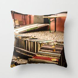 Old books on the street Throw Pillow