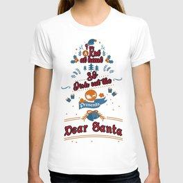 I'm a Kid at heart So dish out the presents Santa funny xmas gift december 25 family joyful Jesus yule jingle bells reindeer naughty nice T-shirt