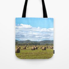 Hay bales on a sunny day Tote Bag