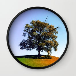 Posing tree on a hill in summertime Wall Clock