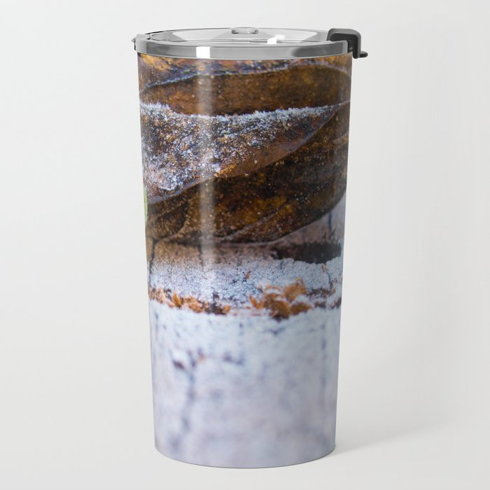 Frosted leaves on the snowy table. Travel Mug