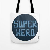 superhero Tote Bags featuring Superhero by Open The Mind