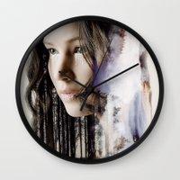 katniss Wall Clocks featuring katniss by phoebe-designs