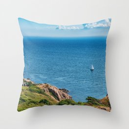 Blue sea with boat and rocky stones Throw Pillow