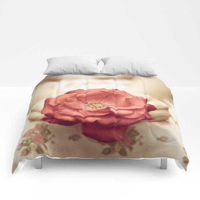 Rose in her hands III Comforters