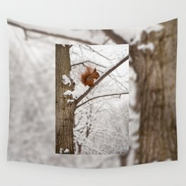 Squirrel sitting on twig in snow Wall Tapestry