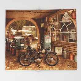 Nostalgic garage with tractor and motorcycle Throw Blanket
