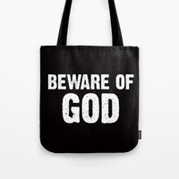 atheist Tote Bags featuring BEWARE OF GOD by Rob Collinet