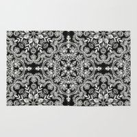 folk Area & Throw Rugs featuring Black & White Folk Art Pattern by micklyn