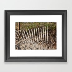 Beach fence with erosion Framed Art Print