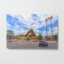 A tuk tuk drives past the Giant Swing. Wat Suthat is in the background. Bangkok, Thailand Metal Print