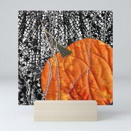 Pumpkin on black Mini Art Print