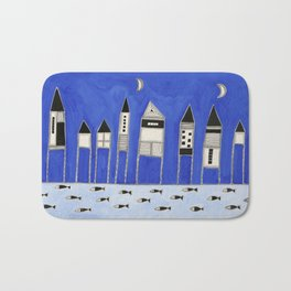 Tiny houses and fish in blue Bath Mat