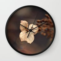 uncharted Wall Clocks featuring The Optimist by Astrid Ewing