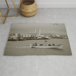 Small boat in the bay Rug