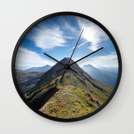 Mountain top with cloudy sky Wall Clock