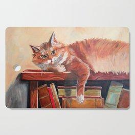 Red cat on a bookshelf Cutting Board