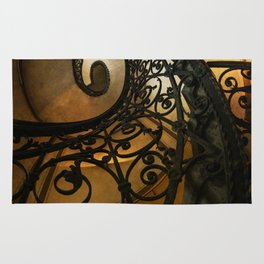 Spiral staircase with ornamented handrail Rug