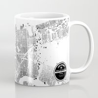 new orleans Mugs featuring NEW ORLEANS by Maps Factory