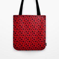 Dark stars on grunge textured bold red background Tote Bag