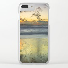 Cloudy sky at the beach with sunset reflection on the sand Clear iPhone Case