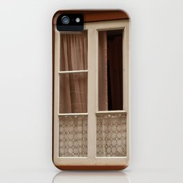 Window in a brown wall iPhone Case
