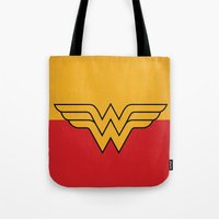 dc comics Tote Bags featuring Wonder Logo Woman Minimalist Art Print DC Comics by The Retro Inc