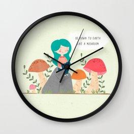 Be down to earth like mushroom; Cute girl sitting on stone Wall Clock