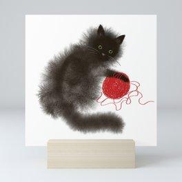 Mischievous cat Mini Art Print