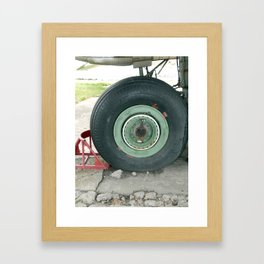 Aviation chassis of an airplane and a helicopter at the airport Framed Art Print