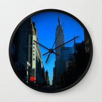 gotham Wall Clocks featuring Gotham City by The Electric Blue / YenHsiang Liang