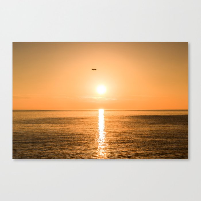 Flight Over The Sea At Sunset Canvas Print
