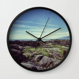 Between sea and sky Wall Clock