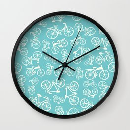 Bikes in a blue background Wall Clock