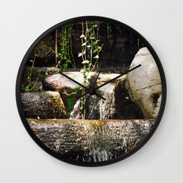 dreamy water flowing over old Asian stones Wall Clock