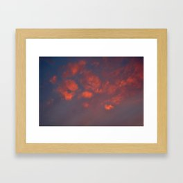 Red clouds shining at sunset Framed Art Print
