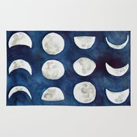 moon phases Area & Throw Rugs featuring Moon phases by Bridget Davidson