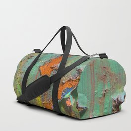 Flaking Paint on Rust Duffle Bag