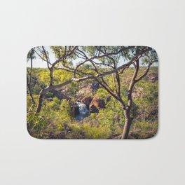 Edith Falls framed between trees, Katherine, Australia Bath Mat