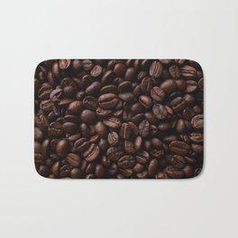 Dark roasted coffee beans arranged as flat background Bath Mat
