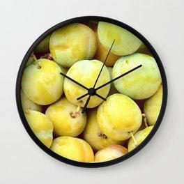 Yellow plums heap. Background shot. Wall Clock