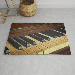 Well worn piano and keys. Rug
