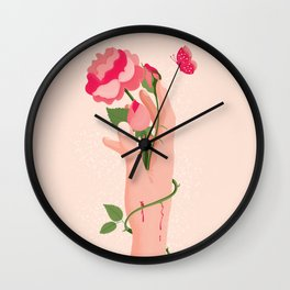 Rose flower with thorns in hand, pain and pleasure Wall Clock