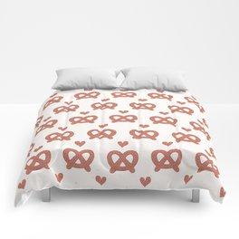 Cute vector german pretzel cartoon with love heart. Comforters