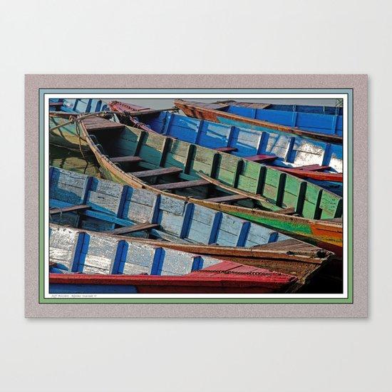 COLORFUL CANOES ALONG PHEWA LAKE SHORELINE POKHARA NEPAL Canvas Print
