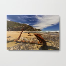 Rusty Anchor in the Rocks on the Sea Shore Metal Print