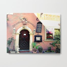 Flowers, old world buildings and a knick-knack rack. Metal Print